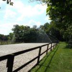 Paardrijbak beregening